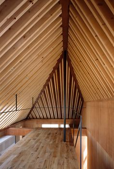 Featuring an asymmetric pitched roof, this three-storey building provides a home for a family of four on a narrow site in Mitaka – a newly established city on the outskirts of the Japanese capital.