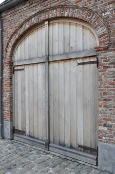 Greet's brick garage with it's lovely aged Oak doors.