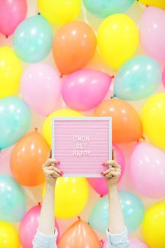 How's this for a party? We wanted to do something fun and a little special with our pal Kelly's balloons from her balloon shop, and I figured since she's so festive a DIY photo backdrop would be in order!