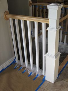 painting and staining a stair banister - TDA Decorating and Design featured on @Remodelaholic
