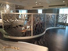Laser cut curved screen. Harrods, Knightsbridge London. 3rd Floor Bed studio. Feather design by Miles and Lincoln. www.milesandlincoln.com