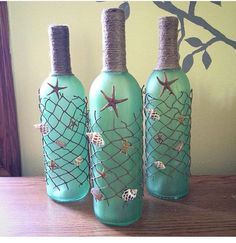 This Color But Tied Cross Cross Beach Themed Wine Bottles With Starfish,  Seashells, And Beach Netting By (null) On Etsy (null)