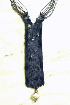 Tie in blu linen thread and silver bead nr. 124 by IfatNesher
