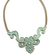 Bronzed gold & mint green statement necklace Beautiful and unique fashion jewelry statement necklace. New piece. Antique/oxidized gold frame with mint green color to add a rustic look.  Length = 21 inches end to end. Bib part of necklace in front hangs 2 inches long. Adjustable lobster clasp.   10% discounts on bundles! Make offers through offer button only please! Any questions please ask.  Jewelry Necklaces
