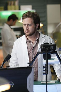 """CSI NY - Adam Ross is a Lab Technician.His specialty is trace evidence. He sometimes accompanies the CSIs to crime scenes to aid in reconstruction or evidence collection.  - Alan John """"A. J."""" Buckley (born February 9, 1978) is an Irish-born, Canadian television and film actor"""