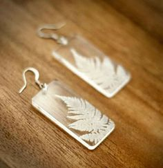 Etched Ferns | Brickbubble — Make a statement with these clear acrylic earrings! Laser engraved ferns almost appear ice like… this in-house etched artwork is an original design. The delicate fern leaf almost appears to be floating. Rectangles measures 8″ wide (2.2 cm) x 1.7″ tall (4.4 cm), fitted with sterling ear wires.