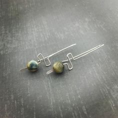 Making 100 pairs. #blogher16 #theartisangroup #tigereye #jewelry #earrings #sterlingsilver