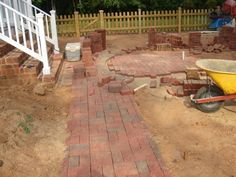 We salvaged as many old bricks from around the house as we could find and used them around the brick circle.