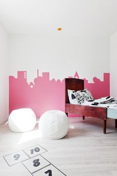 """Love the simplicity of this city skyline ihn pepto bismal pink... Simple and fun -- easy to paint away """"next year""""...Scandinavian Deko"""