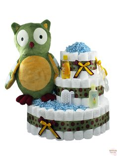 "Enchanted Owl Diaper Cake 3 Tier - Our Enchanted Owl Diaper Cake is an absolute hoot!  Included are over 100 Pampers Swaddlers size 1 diapers, a large plush owl, a teething ring and various baby products.  Bringing this gift to your next baby shower would be a ""wise"" choice!   $118 - http://www.rattlecake.com/diaper-cakes/enchanted-owl-diaper-cake-3-tier.html"