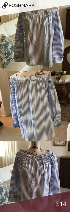 Blue & White Stripe off the shoulder top Classic blue and white striped top. Can be worn off the shoulders or not because there is elastic around the neck. The sleeves are cuffed with buttons, roll up or leave it down, small slits  at the sides. Although it says large it fits more like a medium. Marci Tops Blouses