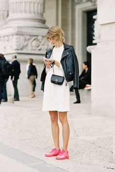 Pretty white dress with black leather jacket and bag - love the pink nikes - street style by vanessa jackman