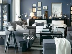 Bedroom Gorgeous Living Room Decoration With Cozy White And Grey Sofa Also Black Table Combine Blue Wall Paint Color Dark Flooring