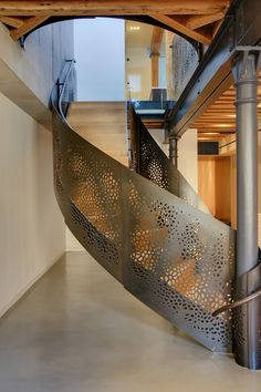 Paying homage to the fancifulness and ornamentation of 17th century Edmund Pearce staircase, Workshop/apd created this contemporary update in laser cut steel and perforated steel railing of the stair weaves the two floors of this Tribeca New York loft together in a unique way. Fabricated by FERRA DESIGNS INC.