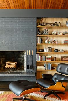 Shelving unit next to fireplace | 14 Photos Of A Flawlessly Cool Mid-Century Modern Home | Airows