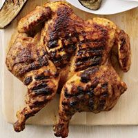 Roasting a whole chicken takes about an hour, but cut out the backbone and flatten the bird and it will grill perfectly in 30 minutes. Melissa Rubel Jacobson rubs the chicken all over with a very simple, Thai-inspired mix of red curry paste, coconut milk and brown sugar.