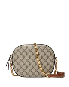 """Beige/ebony GG supreme canvas bag with brown leather detail. Golden metal hardware. Chain shoulder strap with 22"""" drop and leather shoulder panel. Zip closure. Camel Alcantara fabric lining with a sue"""