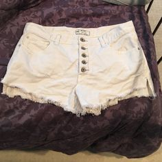 FP white distressed high waisted shorts Free people size 29 white high waisted shorts distressed style denim Free People Shorts Jean Shorts