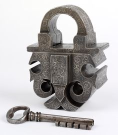 "Masterpiece Padlock & Key, Southern Germany, Steel, ca 1580. ""To become a master locksmith an apprentice had to produce a 'masterpiece'. Here the locksmith demonstrated his skill by creating a robust & secure lock & refining its appearance with delicate etching."""