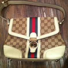 Authentic Gucci-AUTHENTIC!!!! Perfect condition. No stains. Was given to me as a form of payment when my former roommate couldn't pay rent. No dust bag. Trade value $400 Gucci Bags