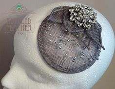 Silver grey bridal sinamay headpiece by TheRuffledFeatherBou