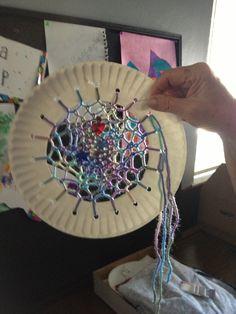 Kid fun. Paper plate, yarn, hole punch. Homemade dream catcher.
