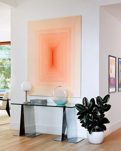 One of the delights @ricky_martin and @jwanyosef found in settling into their new home was the ability to incorporate works from the couple's nascent but growing art collection, which largely eschews the predictable trophies of contemporary acquisition in favor of intriguing, lesser-known young artists' creations via @archdigest