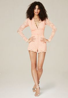 Devastatingly sexy lace romper with a deep V-neck, sheer back and scalloped edges. Hidden back hook-and-eye and zip closure. Partially lined.