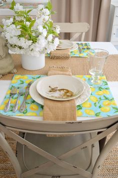 Create a simple Spring table to celebrate Easter. I'm having fun with HomeGoods aqua and lemon placemats and the sweetest Pottery Barn bunny plates!