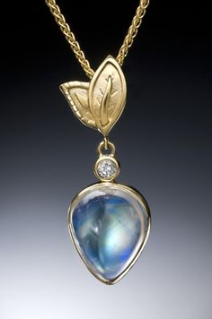 Gorgeous rainbow moonstone and diamond pendant in 18K yellow gold by Conni Mainne
