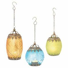 """Set of 3 hanging glass candle lanterns with assorted finishes and filigree trims.  Product: 2 Small and 1 large candle lanternConstruction Material: Metal and glassColor: Orange, blue and greenAccommodates: (1) Candle each - not includedDimensions: 7.25"""" H x 4.75"""" Diameter (large)"""