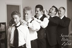 groom and his groomsmen getting ready. Wedding photo.