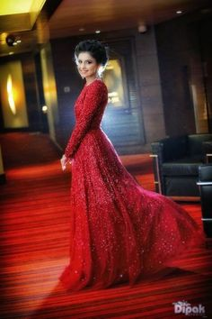I recommend this all red ball gown. It's a proper reception dress for a bride, and the detailing on it is speaking volumes. Indian Wedding Gowns, Indian Gowns, Pakistani Wedding Dresses, Indian Outfits, Bridal Dresses, Red Ball Gowns, Red Gowns, Reception Gown, Long Sleeve Gown