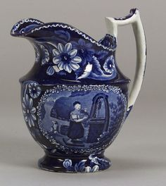 Blue Transfer Decorated Staffordshire Pitcher, James and Ralph Clews, Cobridge, 1817-34, the pitcher decorated with oval reserves depicting a woman at a well with a dog nearby, and floral borders