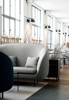 Bright and airy restaurant The Standard in Copenhagen. Stunning Danish design by Fredericia. Haiku sofa in grey designed by GamFratesi.