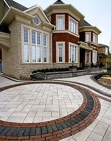 The accent bricks on this driveway give it a boldness that will keep people thinking about this house/driveway even after they've already driven by.