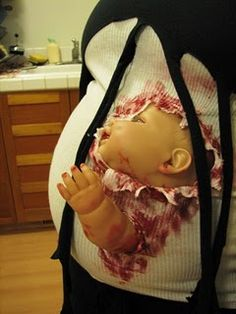I think one of my pregnant friends should totally do this for Halloween!