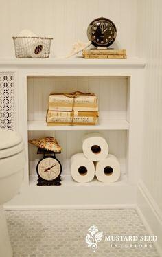 Gorgeous bathroom with marble hex tiles floor, beadboard backsplash, white lattice radiator cover and vintage wire baskets. Bathroom Radiators, Bathroom Renos, Bathroom Toilets, Bathroom Gray, Washroom, Master Bathroom, Bathroom Ideas, Toilet Shelves, Toilet Paper Storage