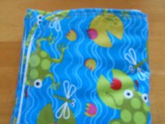 Baby blanket for a baby boy with frogs on the water on one side and blue strips on the other side. by MissyCraftsandGoods on Etsy