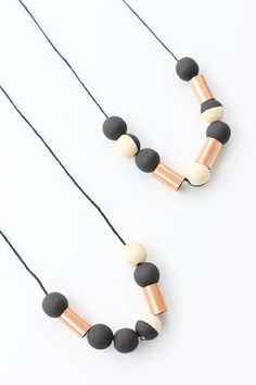 Learn how to make the perfect DIY Fall necklace using wood beads and copper couplings from the hardware store.