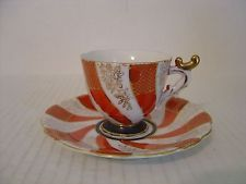 VINTAGE DEMITASSE CUP AND SAUCER ORANGE WHITE AND GOLD SWIRL MADE IN JAPAN