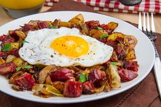 Corned Beef Hash Leftover corned beef never had it so good in the breakfast hash topped with a fried egg.  Servings: 2; Prep: 10min.; Cook: 20min.; Total: 30min.  Ingredients: 1T oil or butter or bacon grease; 1 onion, diced; 2c cooked corned beef, diced; 2c cooked potatoes, diced; salt & pepper to taste; 2 eggs