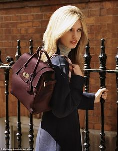 Though former Mulberry campaign face Cara Delevingne has stepped away from fronting the brand, her namesake bag is still a key feature for the new season, carried here by Georgia in oxblood leather