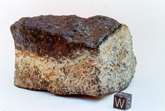 This basaltic meteorites from Mars was found in California's Mojave Desert. A 1-cm cube is shown for size comparison