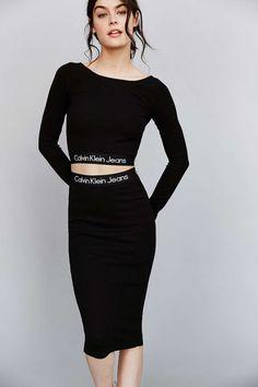 Model wears Long Sleeve Crop Top in Black for Calvin Klein Jeans Lookbook Photoshoot
