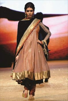 Salwar khameez. loving the cream and black, the polka dotted sleeves...and the volume, from the skirt to the hair.