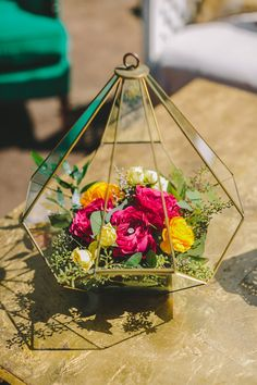 flowers in geometric holders, photo by Orange Owl Photography http://ruffledblog.com/a-whimsical-bohemian-wedding-in-la-jolla #weddingideas #geo