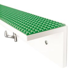 All you need is the Lego baseplate that fits the shelf (you may need to cut a larger one down) and double-sided ...