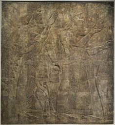 Ashurnasirpal II and a Winged Deity   LACMA Collections Assyrian Northern Iraq, Nimrud, 9th C BC sculpture Gypseous alabaster bas-relief once decorated inner walls of nw palace of Ashurnasirpal II (883-859 BC)