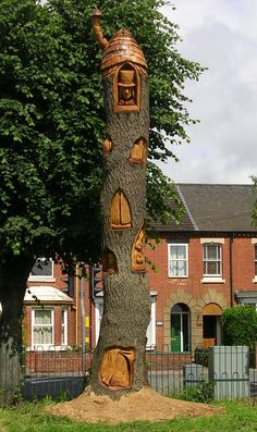 Alice in wonderland wood sculpture